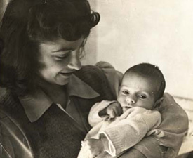 Andrew as a baby, with his mother